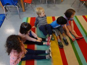 CCK Kids on rug